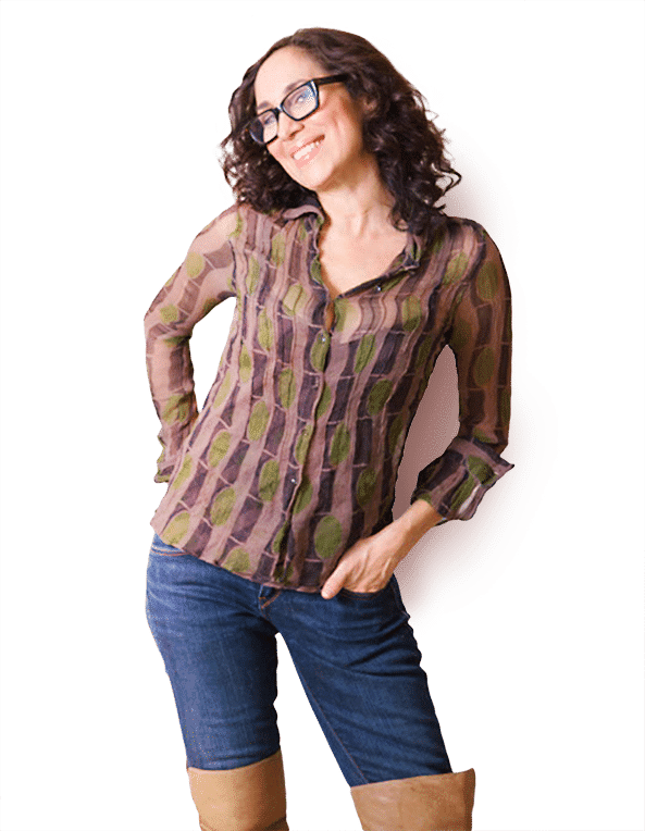 Karen with glasses standing with hand in pocket