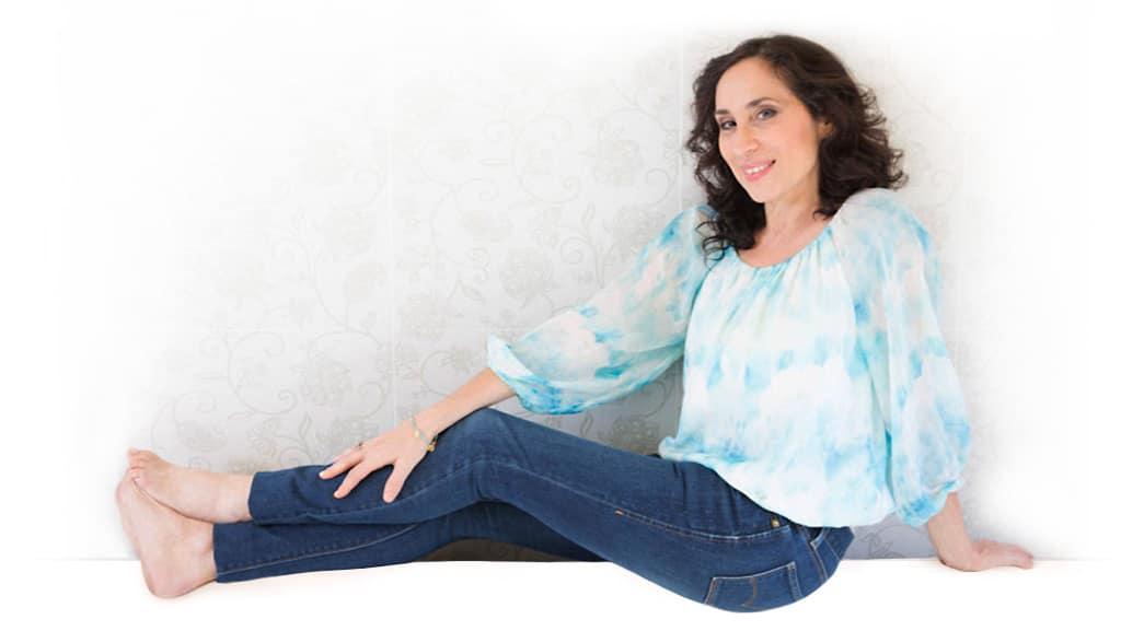 Karen sitting on floor blue shirt and jeans